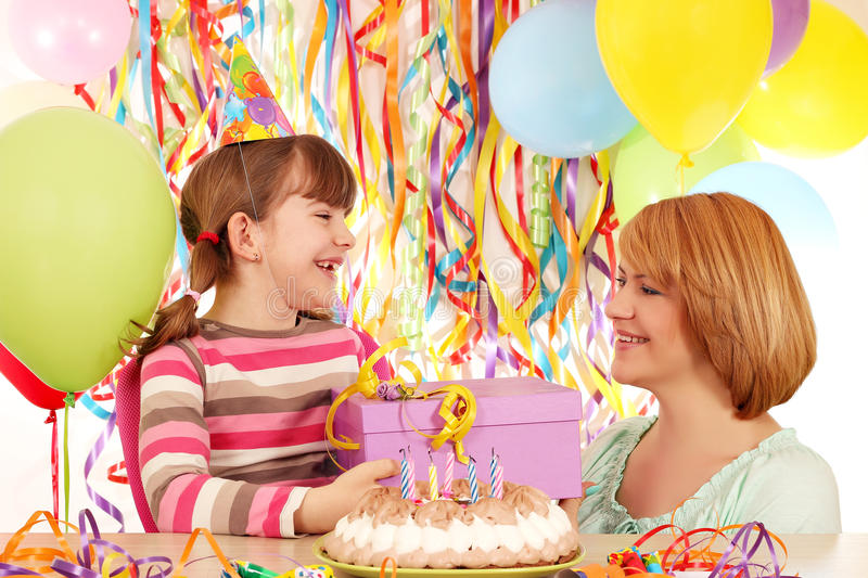 Daughter and mother with birthday gift. Happy daughter and mother with birthday gift royalty free stock images