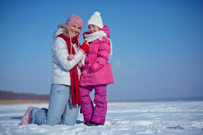 Daughter and mother. Happy women with her daughter outside in winter stock photography