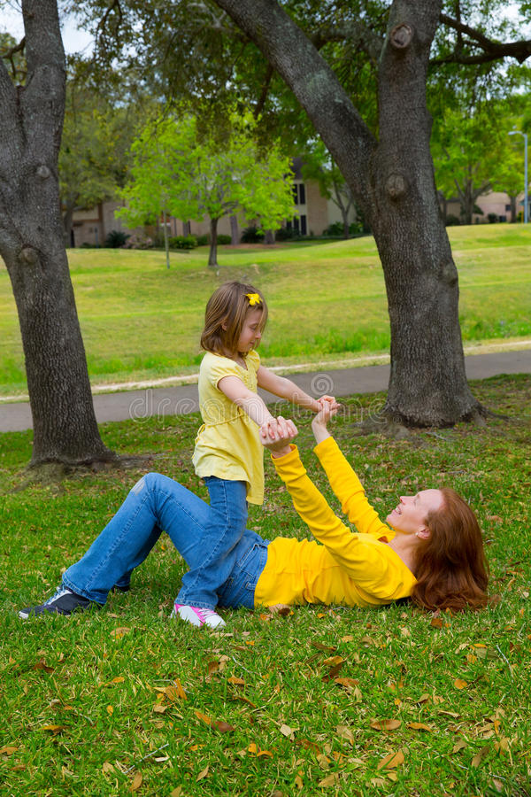 Download Daughter And Mother Playing Lying On Park Lawn Stock Images - Image: 31369514