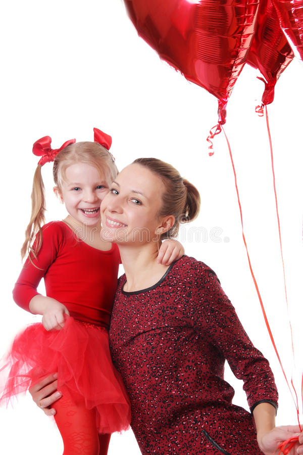 Daughter and mother with red balloons. Happy daughter and mother with red balloons over white stock photo