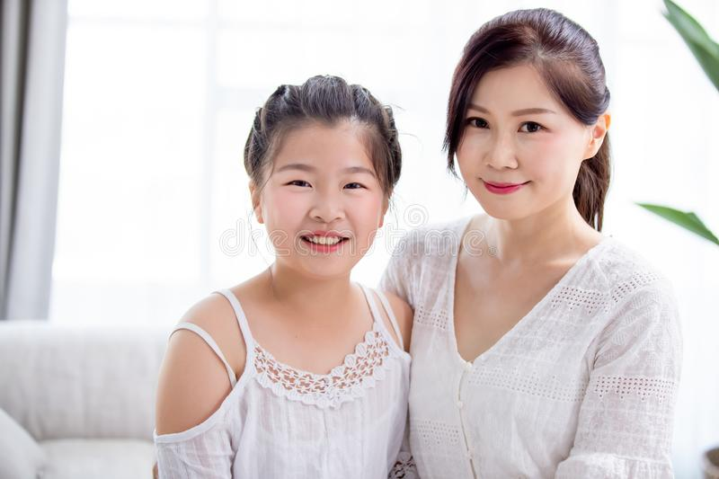Daughter and mother smile royalty free stock photography
