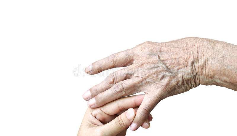 Daughter touching elderly mom hand for take care of royalty free stock photo