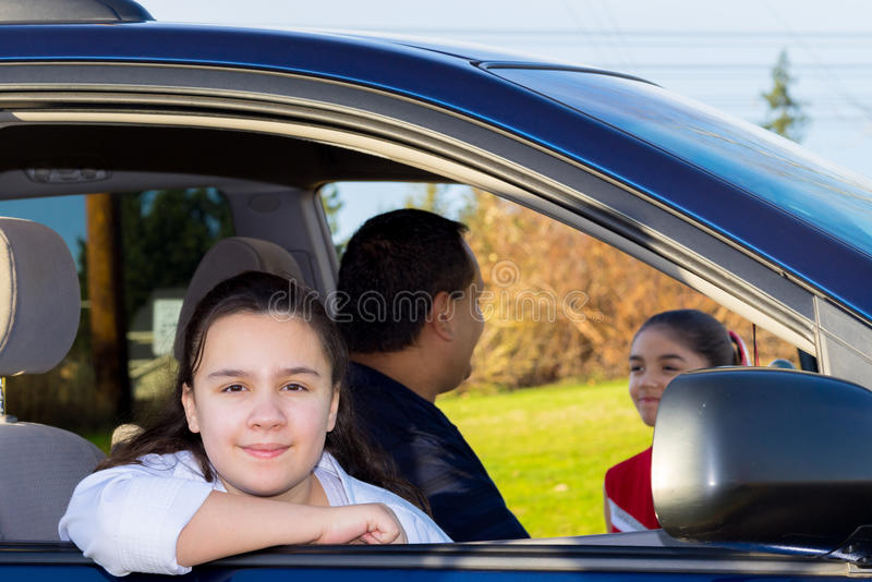 Daughter Waits Patiently As Dad Sends Off Sister royalty free stock photography