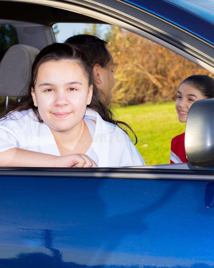 Daughter Waits Patiently As Dad Sends Off Sister stock photo