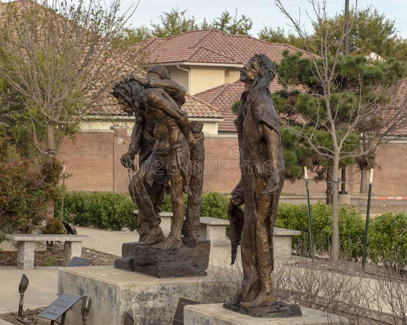 `Daughters Do Not Weep for Me` & `Scourging` by Gib Singleton in the Via Dolorosa Sculpture Garden, Museum of Biblical Art. Pictured are two bronze sculptures stock photo