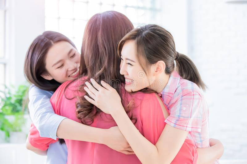 Daughters give mom a hug royalty free stock images