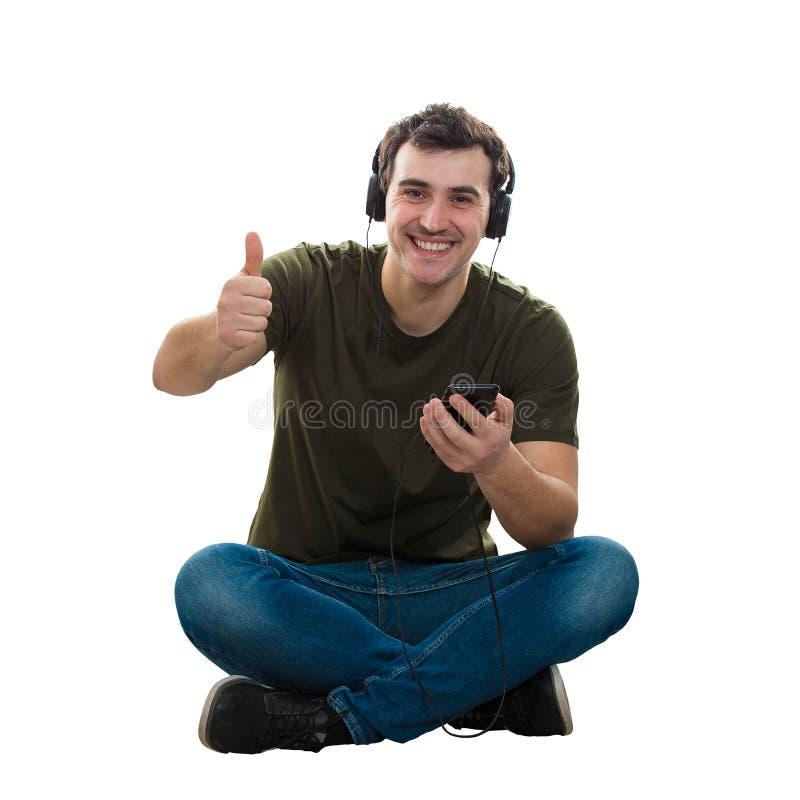 Daumen herauf hörende Musik lizenzfreie stockbilder