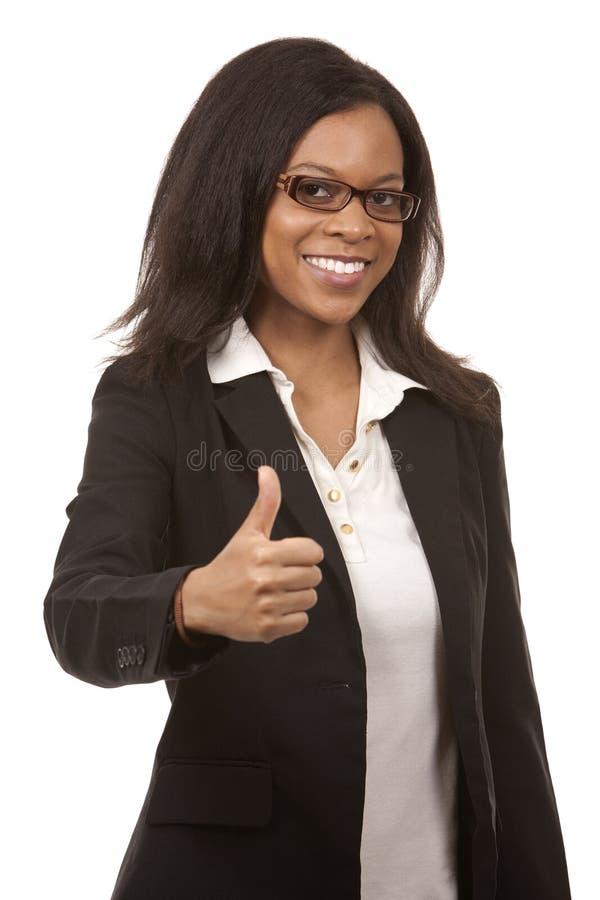 Daumen oben von der Geschäftsfrau lizenzfreies stockbild