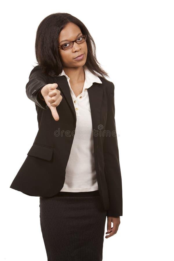 Daumen unten von der Geschäftsfrau lizenzfreie stockfotografie