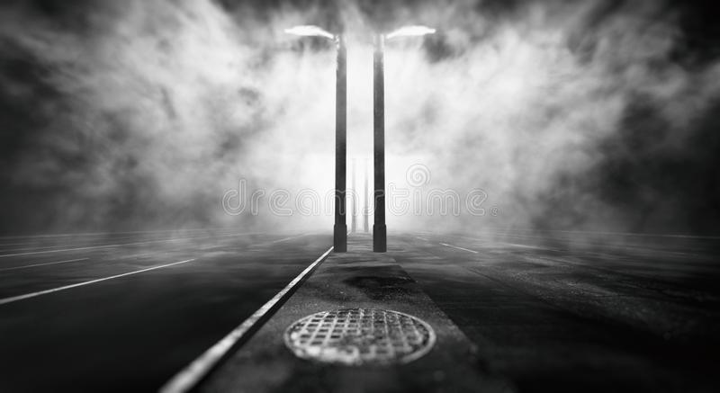 Daunting Road With Fog And Street Lights. Daunting road environment with a haunting atmosphere of mist and volumetric lights coming from the street lamps and royalty free illustration