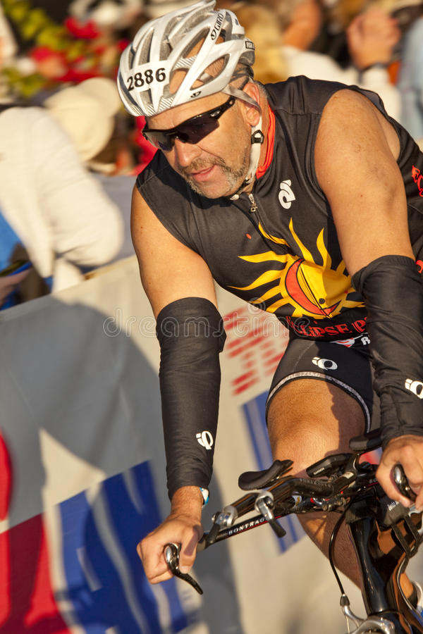 Dave Fish Racing in the Arizona Ironman Triathlon. TEMPE, AZ - NOV. 22: Dave Fish in the cycling stage of the Phoenix Ironman Triathlon on November 22, 2010 in stock photos