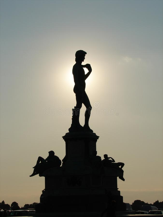 David. Bronze David silhouetted by the setting sun stock image