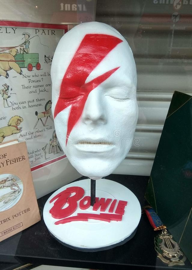 David Bowie`s face sculpture in Dublin. A sculpture with David Bowie`s face in Dublin, at an antique store. It`s Bowie as portrayed on the cover of the album ` royalty free stock images