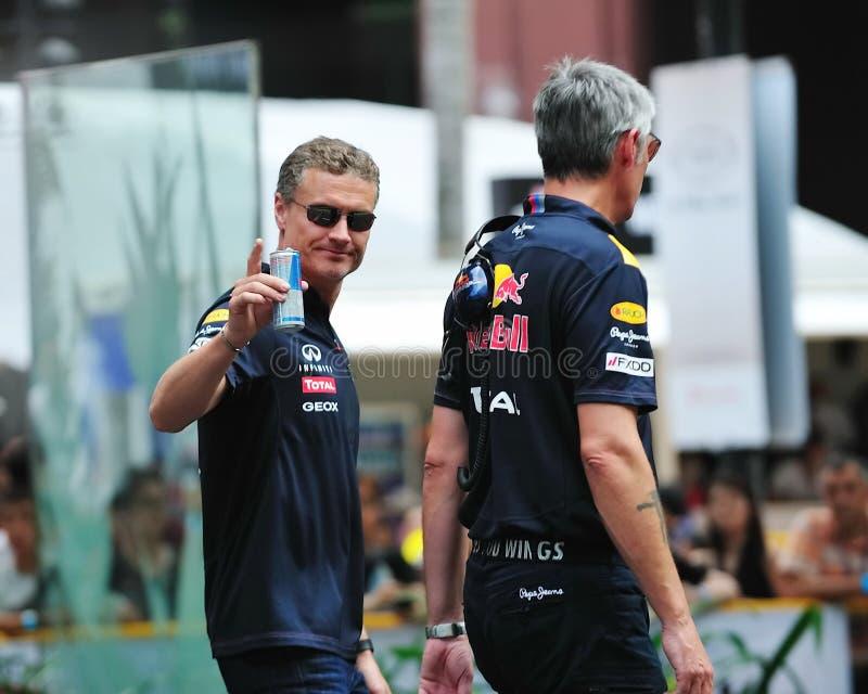 David Coulthard che fluttua agli spettatori fotografia stock libera da diritti