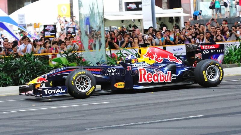 David Coulthard que conduz Red Bull que compete o carro F1 imagem de stock