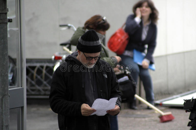 David Fincher standing in a street reading royalty free stock photography