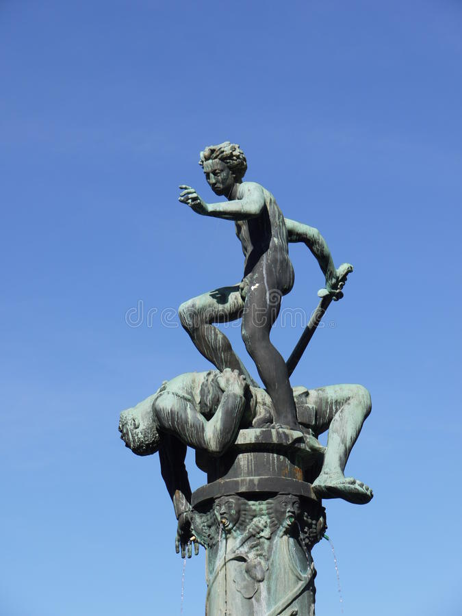 David and Goliath in Kalmar in Sweden. A fountain with a sculpture of bronze in the coastal city Kalmar in Sweden royalty free stock images