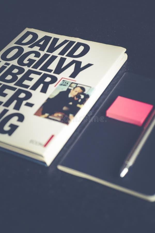 David Ogilvy Book Lying Beside Black Leather Booklet stock images