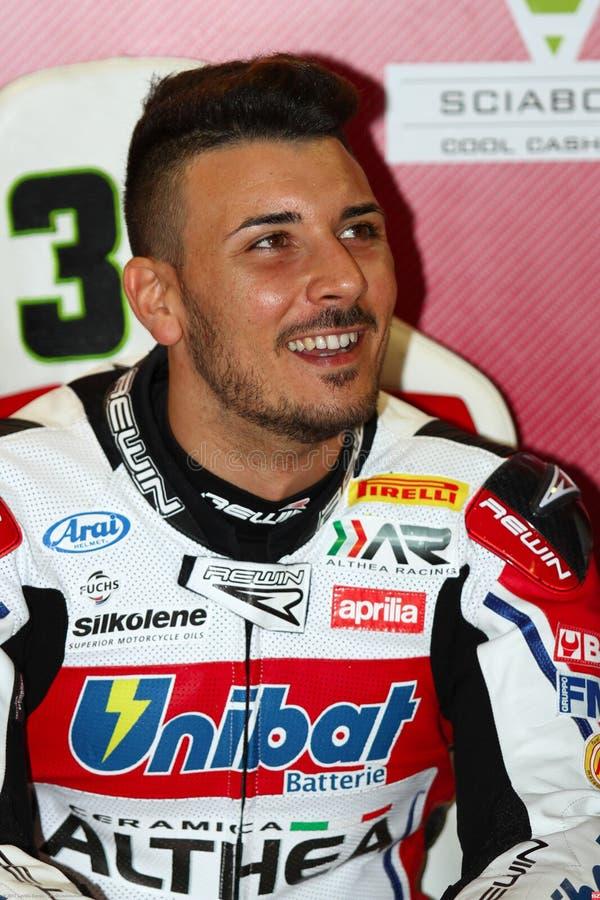 Davide Giugliano #34 sur l'usine 1000 d'Aprilia RSV4 avec Althea Racing Team Superbike WSBK photo stock