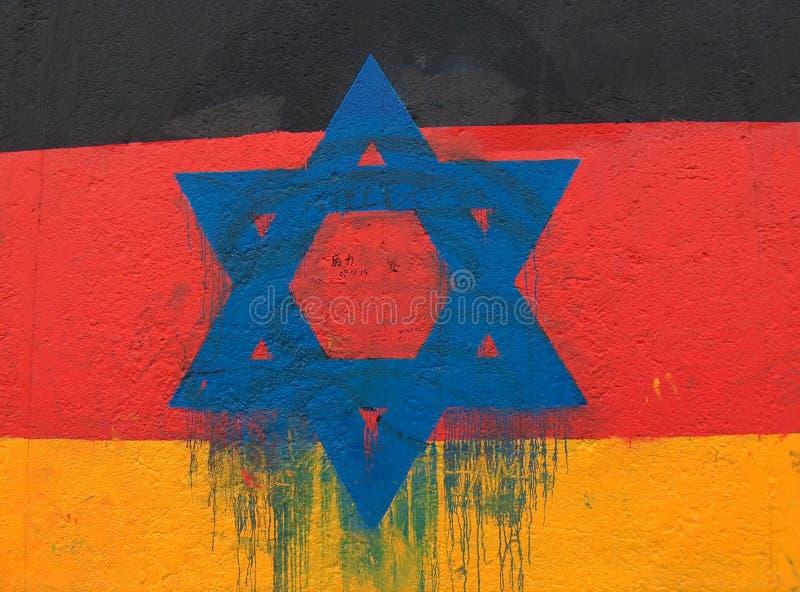 Davidsstern auf einer deutschen Flagge stockfotos