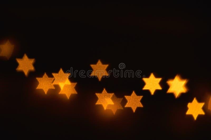 Davidsstjärnaljus för Chanukkah royaltyfria foton
