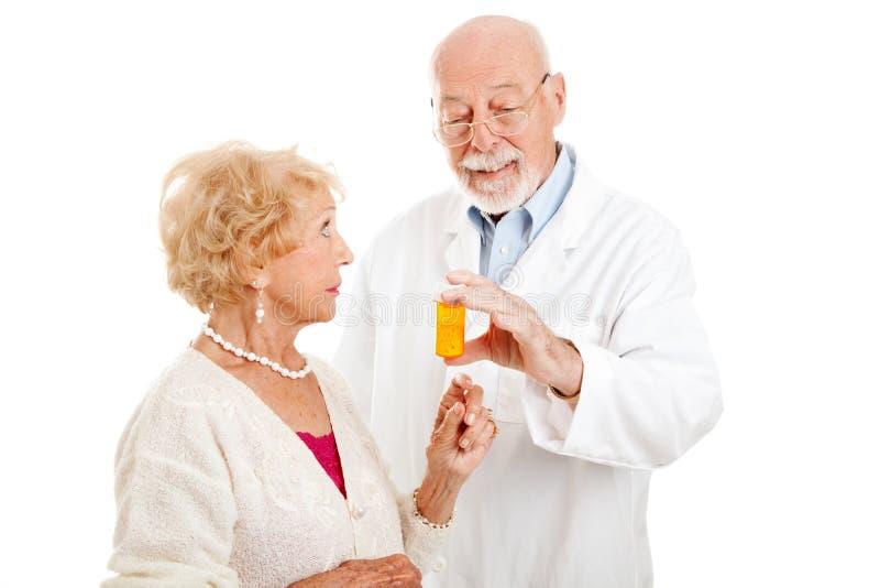 dawać farmaceuty instrukcjom fotografia stock