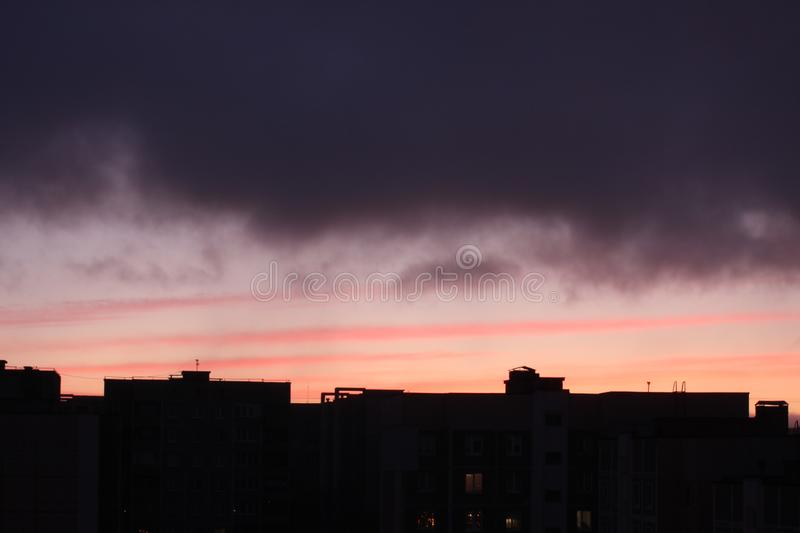 Dawn against the dark sky with clouds, colorful sky from the rising sun stock photography