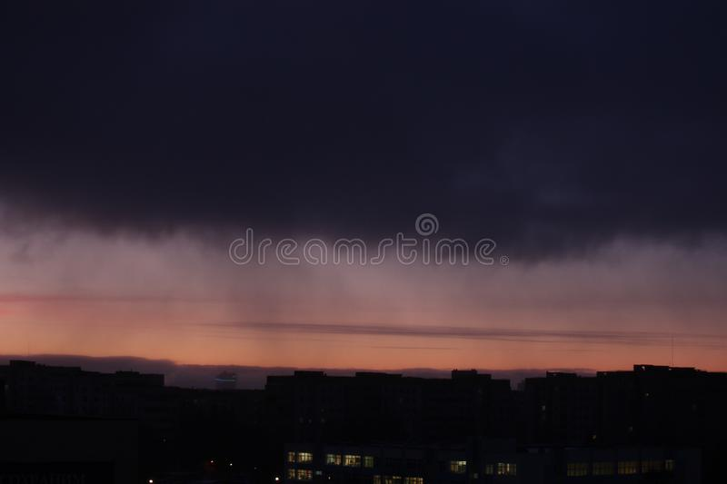 Dawn against the dark sky with clouds, colorful sky from the rising sun. Dawn against dark sky with clouds, colorful sky from the rising sun stock image