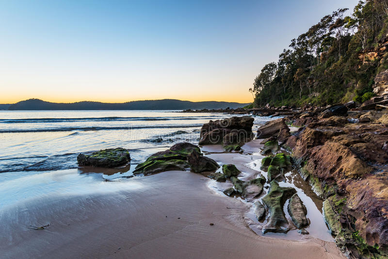 Download Dawn At The Beach With Rocks Stock Photo - Image: 92624660