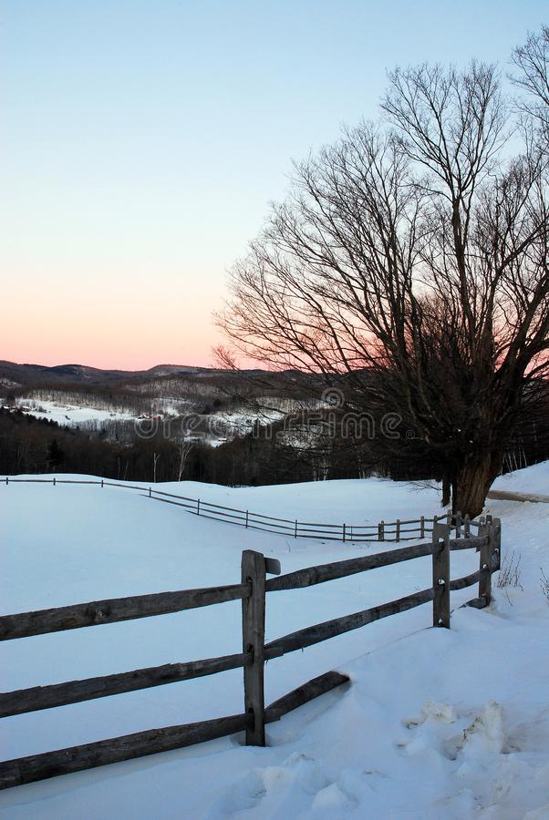 Winter dawn on the farm. Dawn begins to shed light on a rural Vermont winter scene stock image