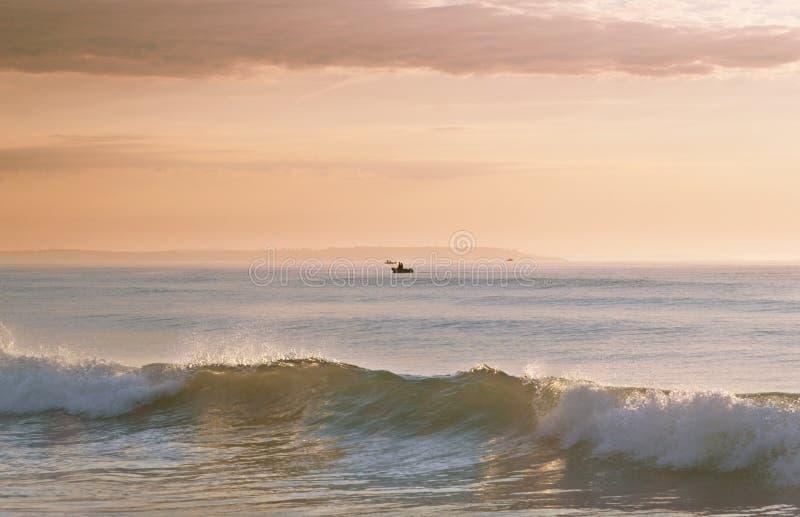 Dawn bij het strand royalty-vrije stock afbeelding