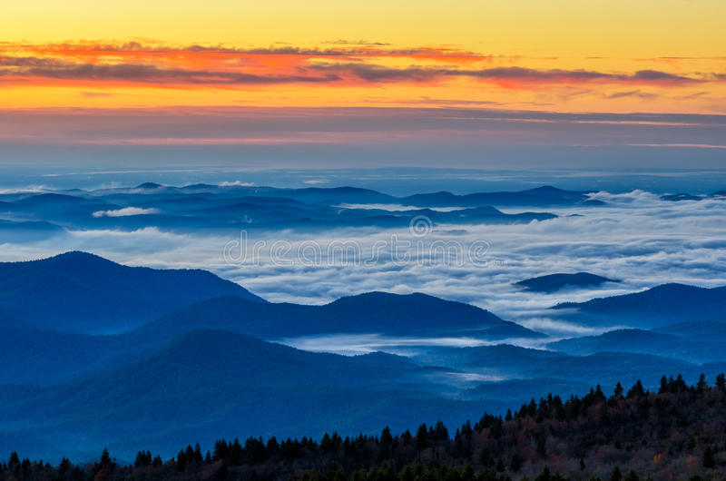 Dawn, Blue Ridge Parkway from Black Balsam Knob. Beautiful predawn glow from atop Black Balsam Knob on the Blue Ridge Parkway. You are looking out towards the royalty free stock photos