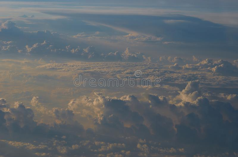Dawn in the clouds on the airplane stock images