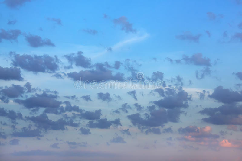 Dawn. Clouds. The clouds are colored by the rising sun stock image
