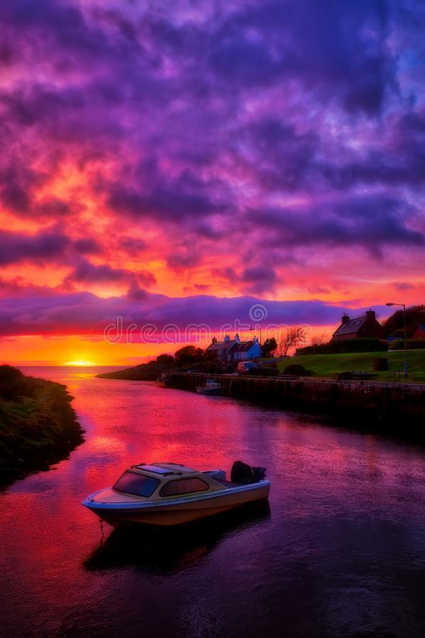 Dawn colours in Brora harbour stock photo