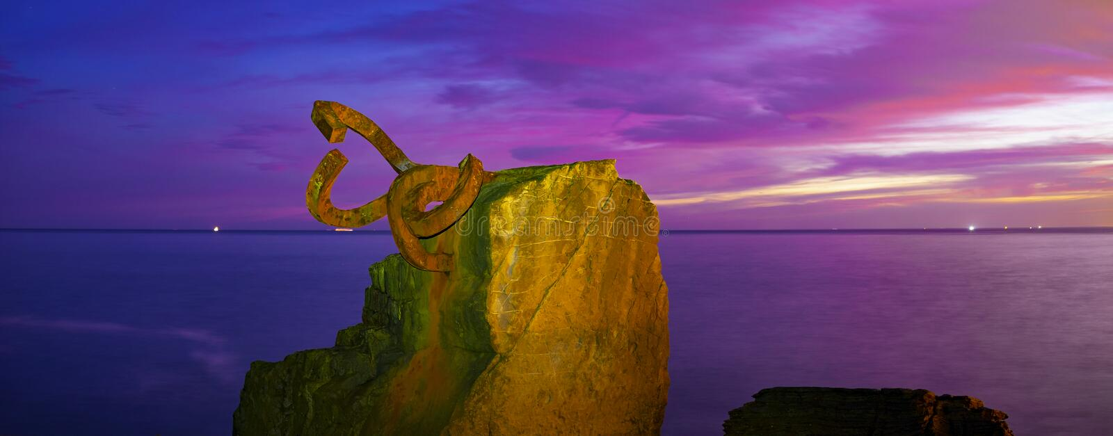 Dawn in the Comb of the Wind Peine del Viento in Spanish sculpture in San Sebastian royalty free stock photo