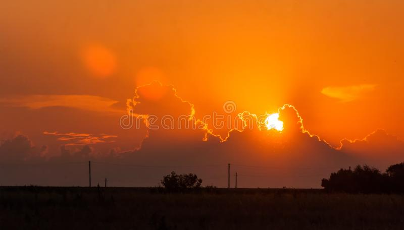 Dawn, dawning, daybreak, daylight, aurora, break of day. Dawn wheat field stock photos