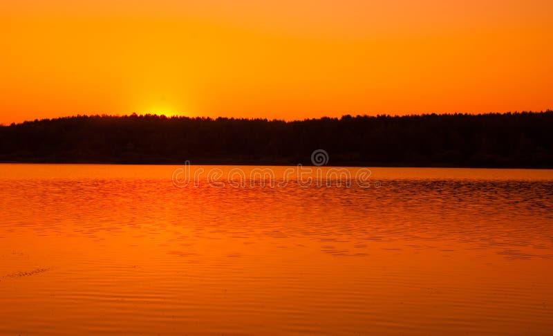 Dawn, dawning, daybreak, daylight, aurora, break of day. Dawn wheat field stock image