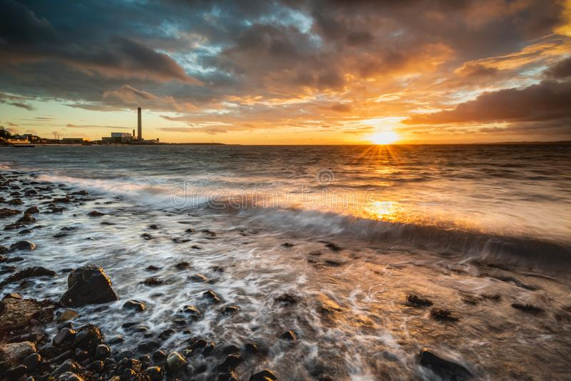 Dawn on Downshire Beach, Carrickfergus,UK royalty free stock photos