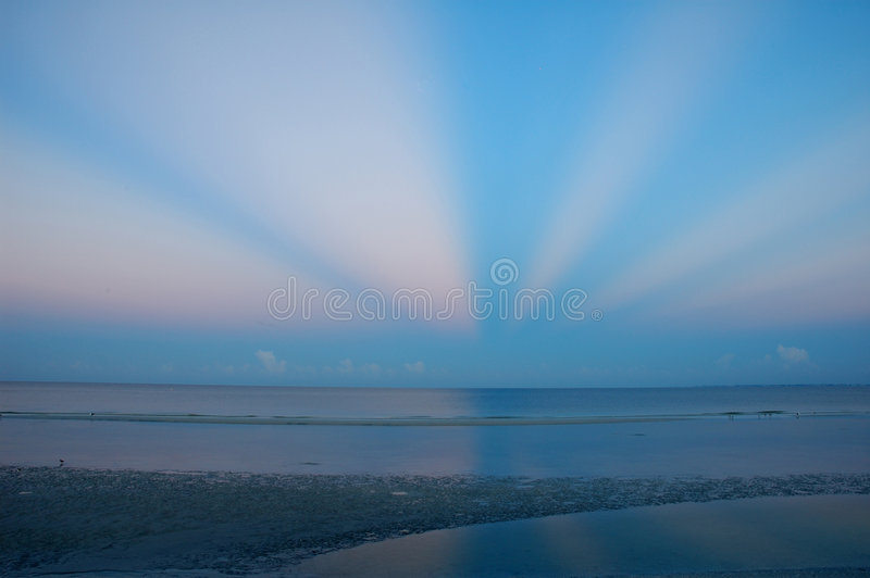Dawn on Fort Myers Beach. With radial cloud burst stock photography