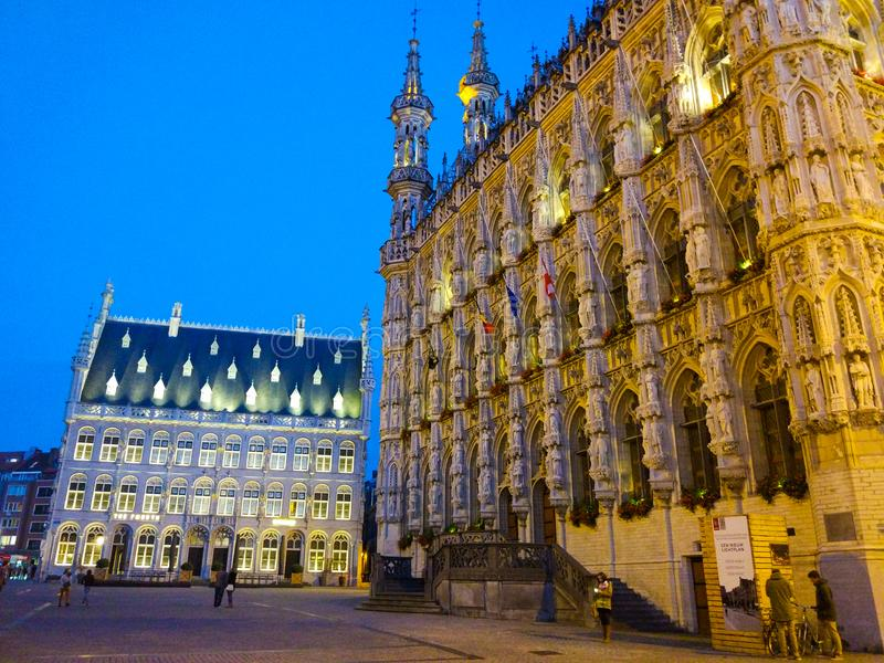 Dawn in Grote Markt Main Market square with the illuminated City Hall in Leuven, Belgium royalty free stock images