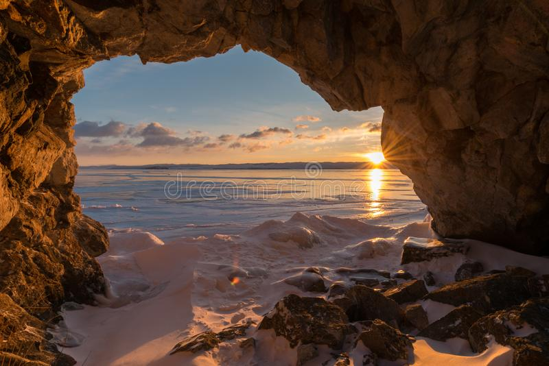 Dawn in the grotto. Winter Baikal lake stock photography