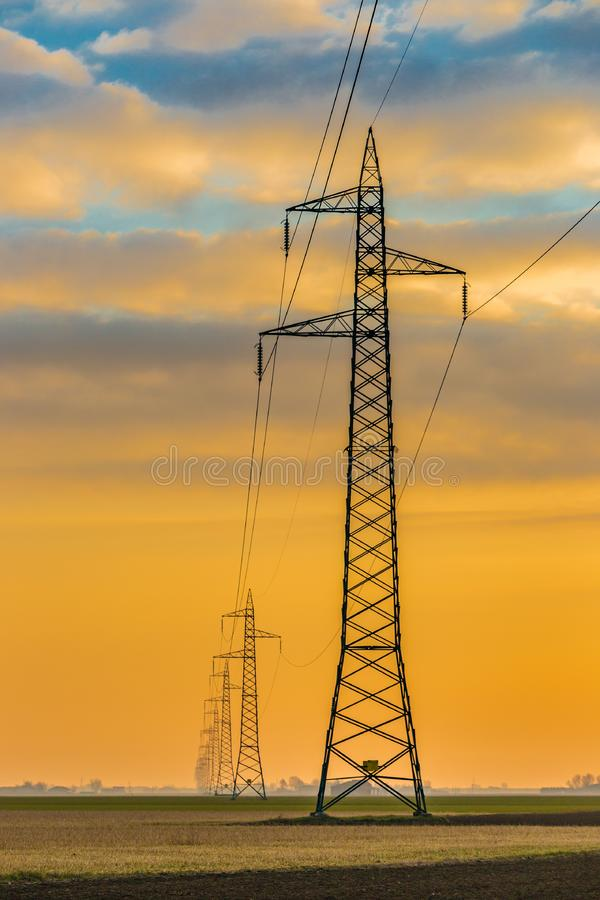Dawn on high voltage pylons. In the Italian countryside royalty free stock images