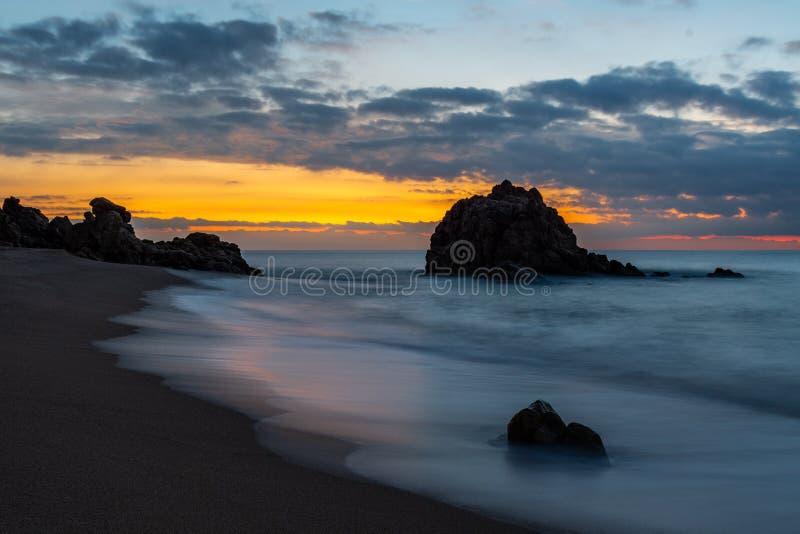 Small beach at sunrise royalty free stock photo