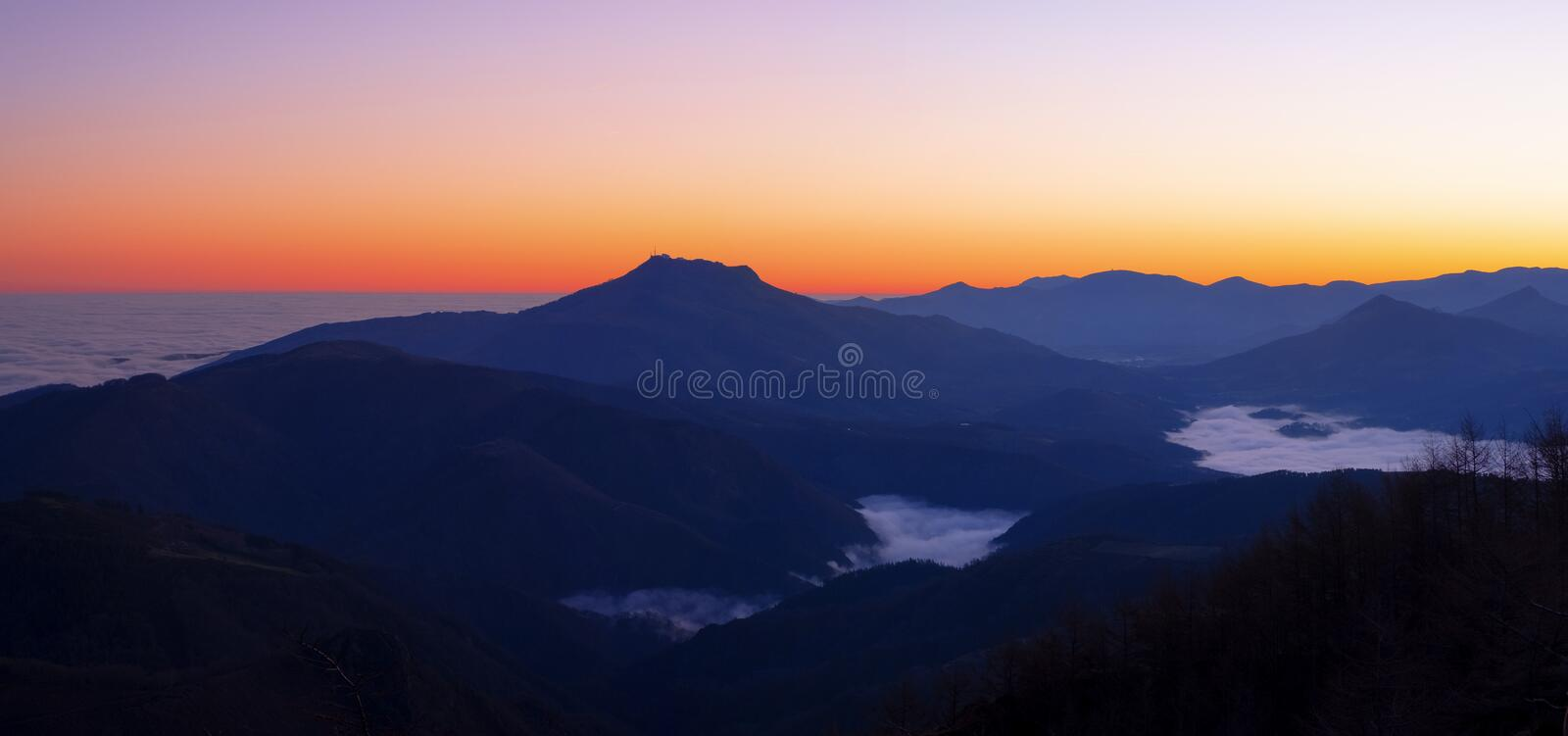 Dawn with mists over the Pyrenees mountains in Euskadi and Navarra, from the Aiako Harriak Natural Park royalty free stock photos