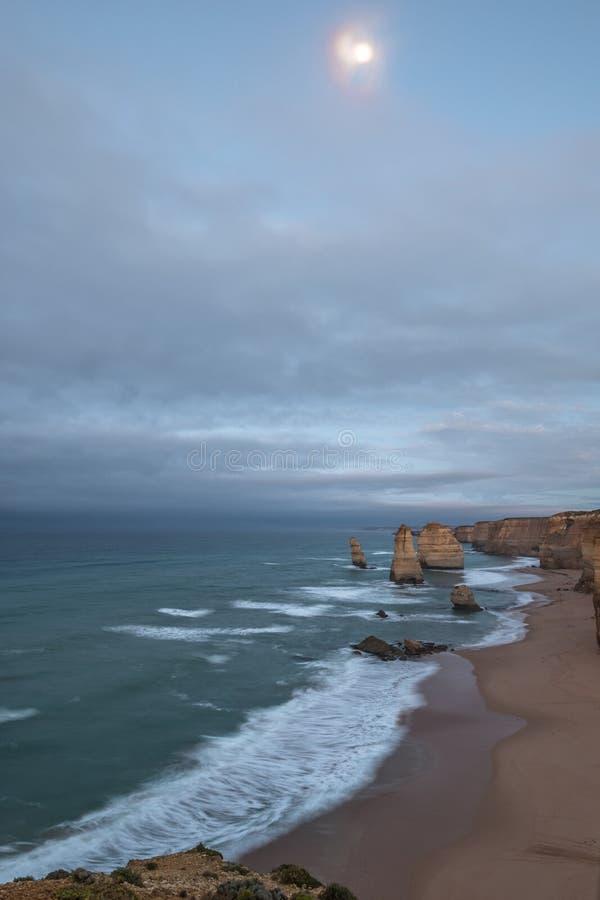 Dawn and moonset: Twelve Apostles, Victoria, Australia stock image