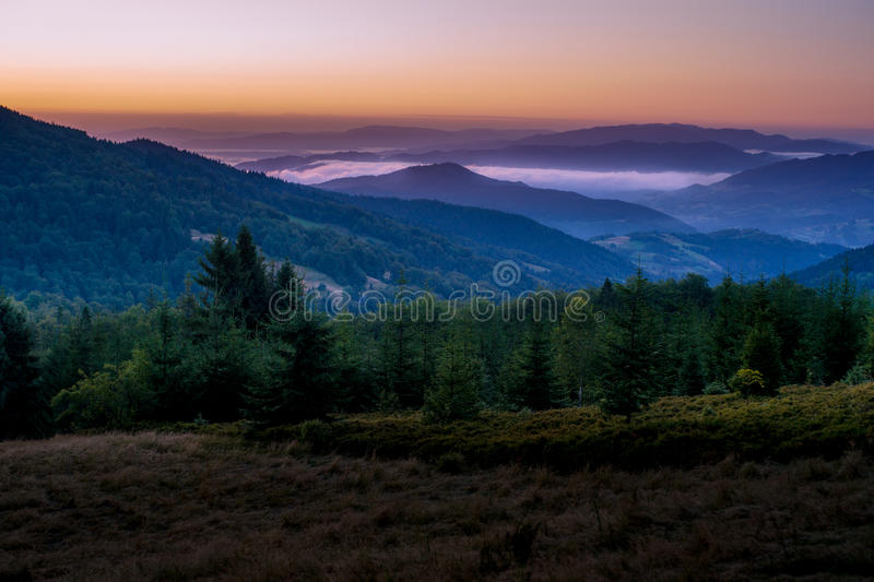 Dawn in mountains. Dawning in Beskidy mountains. View from Gorc on Beskid Sadecki hills stock photo