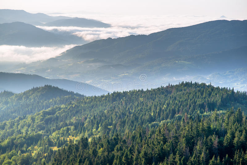 Dawn in mountains. Dawning in Beskidy mountains. View from Gorc on Beskid Sadecki hills at left Dunajec Valley in fog and hills of Gorce Mountains at right Luban royalty free stock image
