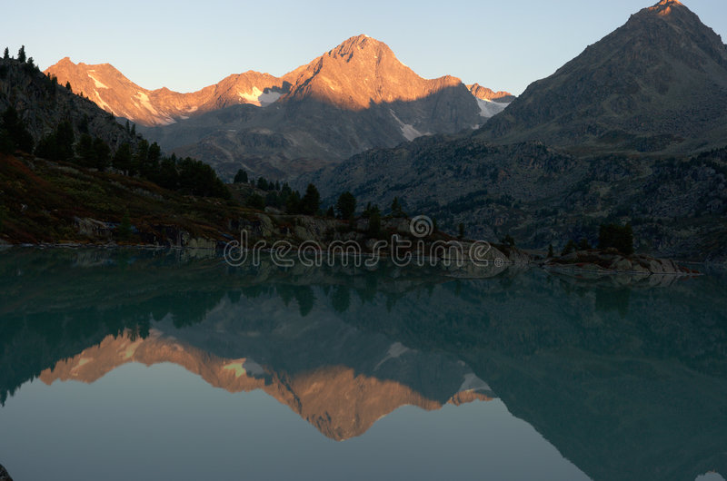 Dawn in mountains lake stock images