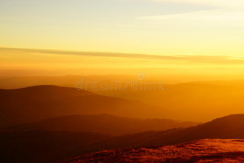 Dawn in the mountains. In Polish Bieszczady mountains a peak is one of the most recognizable massifs Polonina Carynska. Photograph done at dawn from the peak of royalty free stock photos